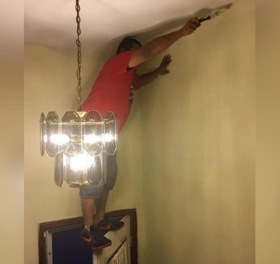 guy painting hallway.jpg